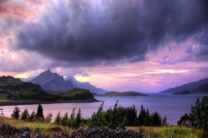 mountainous beach with lowering clouds - photo by GNaharro