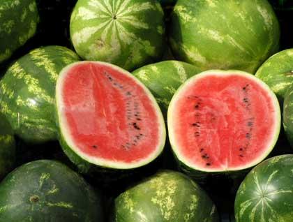cut watermelons - photo by Zela