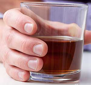 Anxiety, Panic & Health - hand with whiskey glass-