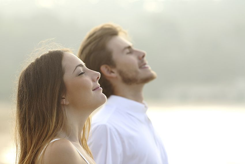Couple Breathing Deeply in Early Morning